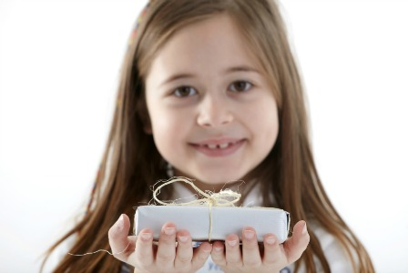 child-holding-gift_bu2bht