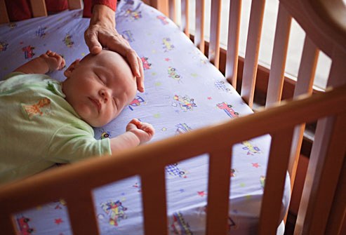 getty_rm_photo_of_mother_putting_baby_down_to_sleep