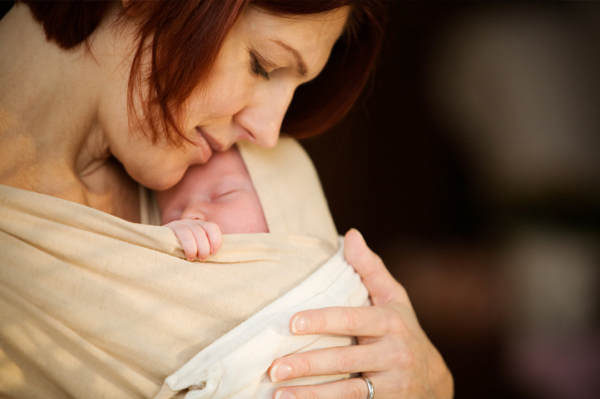woman-holding-newborn_zy53gs